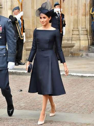 Este foi o look completo da Meghan Markle, sendo a clutch e os scarpins também da Dior - Reprodução/Getty Images
